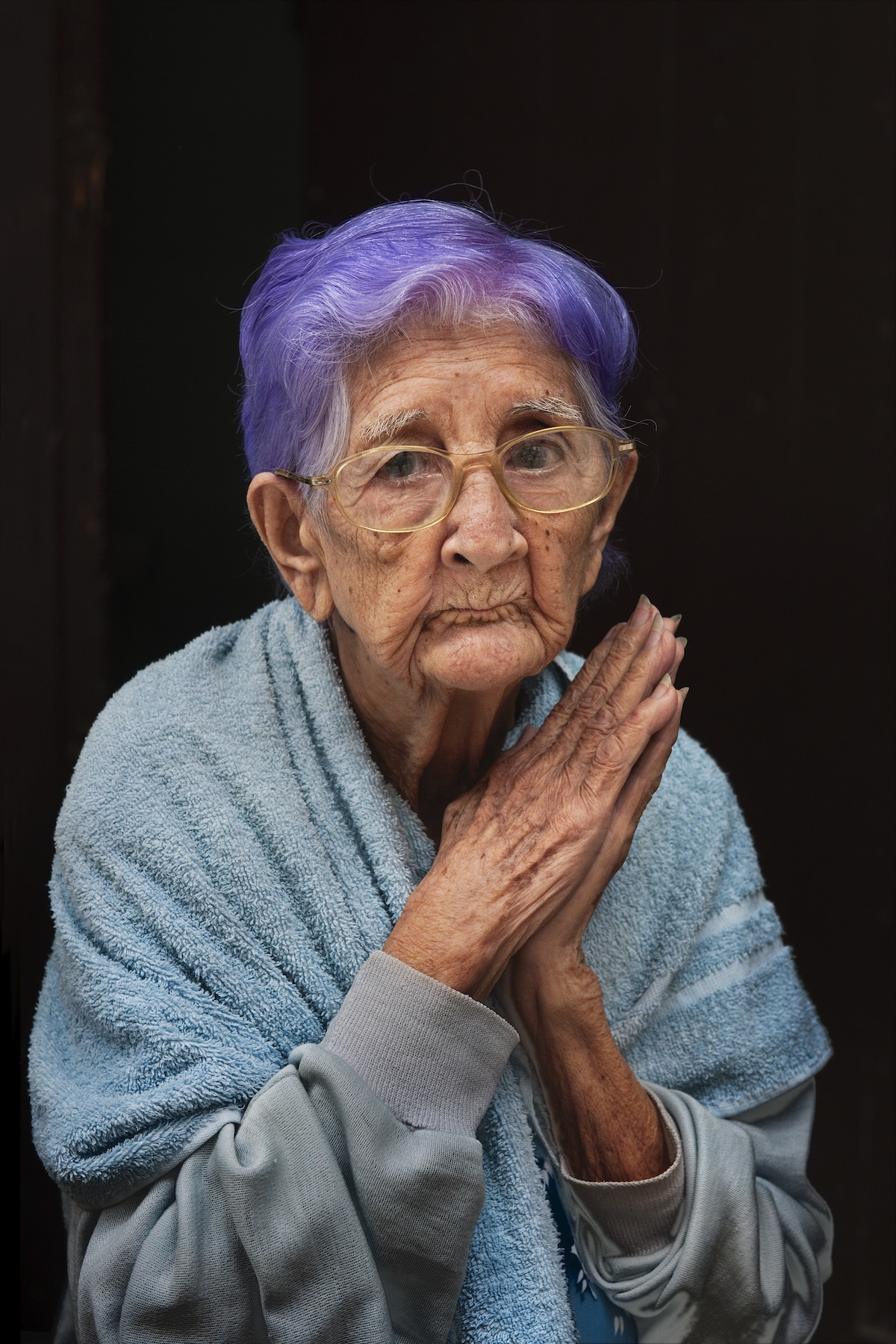 Older Woman with Purple Hair in Havana by Steve McCurry