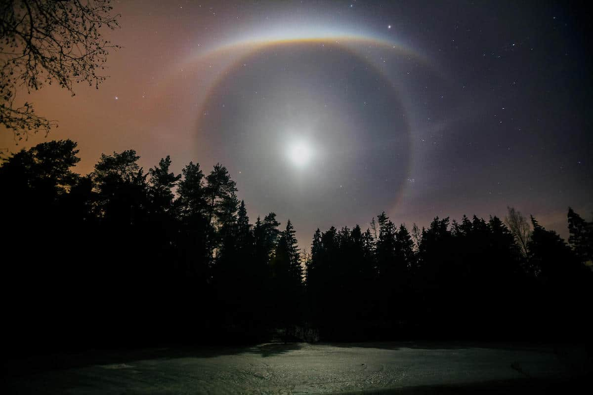 Lunar halo over a forest and lake in Mogilev, Belarus