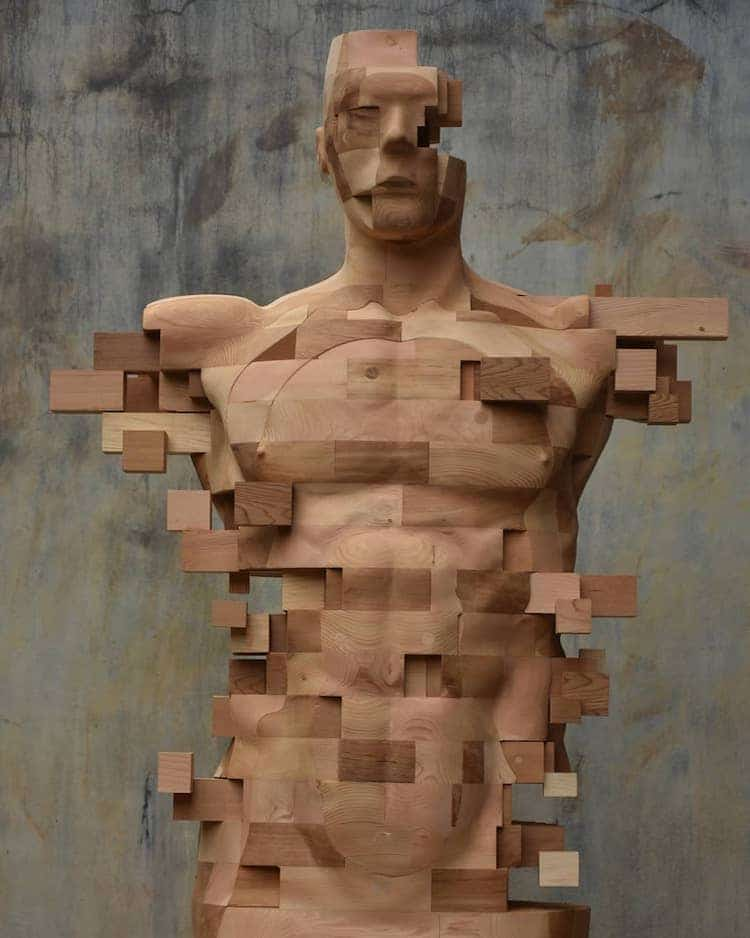 "Wooden Sculpture With Pixel ""Glitches""https://mymodernmet.com/"" width=""750"" height=""938"" srcset=""https://mymodernmet.com/wp/wp-content/uploads/2020/10/han-hsu-tung-wooden-sculpture-4.jpg 750w, https://mymodernmet.com/wp/wp-content/uploads/2020/10/han-hsu-tung-wooden-sculpture-4-240x300.jpg 240w"" sizes=""(max-width: 750px) 100vw, 750px"" /> <p>Taiwanese sculptor <a href=""https://www.instagram.com/han_hsu_tung/?hl=en"" target=""_blank"" rel=""noopener noreferrer"">Hsu-Tung Han</a> fuses traditional woodworking techniques with a visual motif that is distinctly modern. Each of his <a href=""https://mymodernmet.com/hsu-tung-han-pixelated-wood-sculpture/"" rel=""noopener"">wooden portraits</a> is distorted with pixelated ""glitches"" that obscure some areas of the built figure. Part of a face, for instance, is missing or a man"