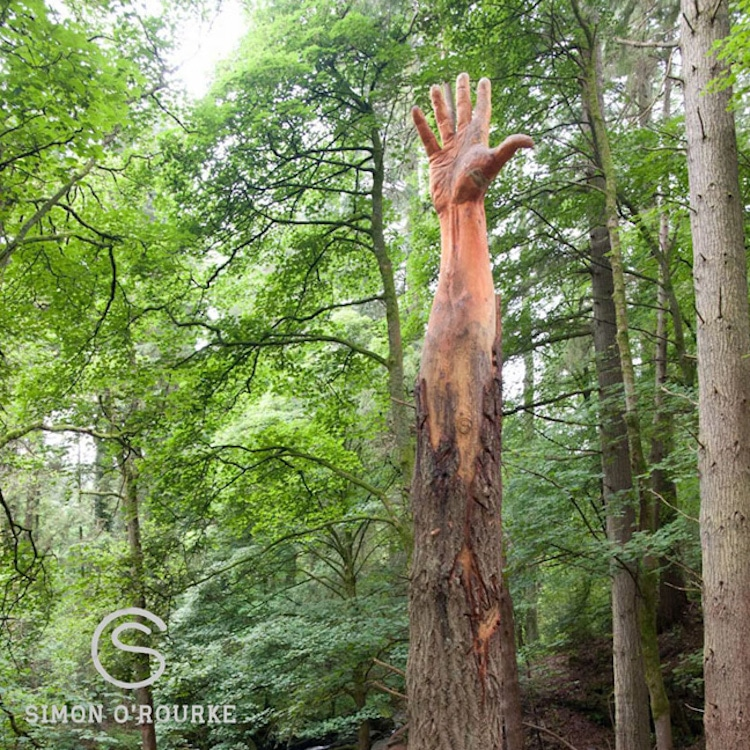 Hand Sculpture Reaching Towards the Sky