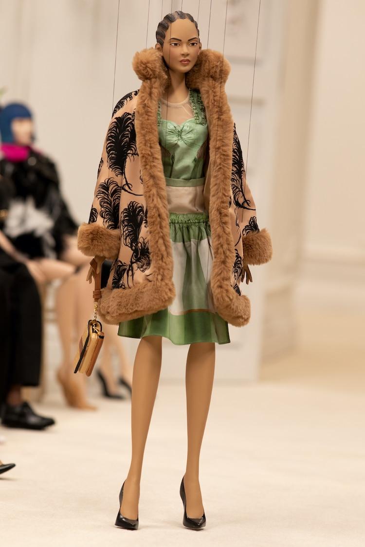 Puppet Wearing Moschino Dress