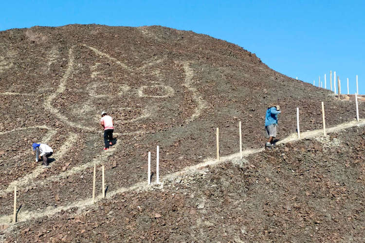 Workers Clearing Cat Geoglyph at Nazca Lines