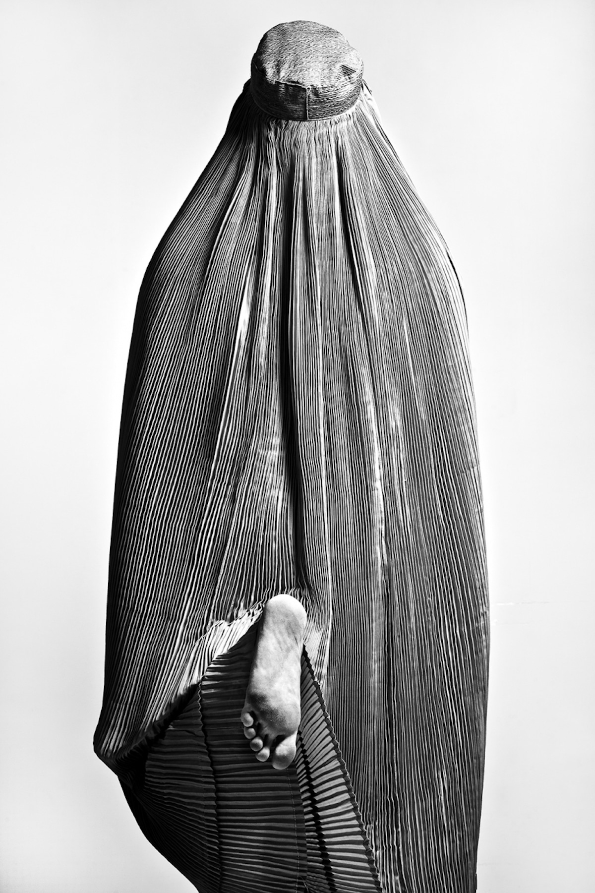 Black and White Photo of an Iranian Woman in a Burka