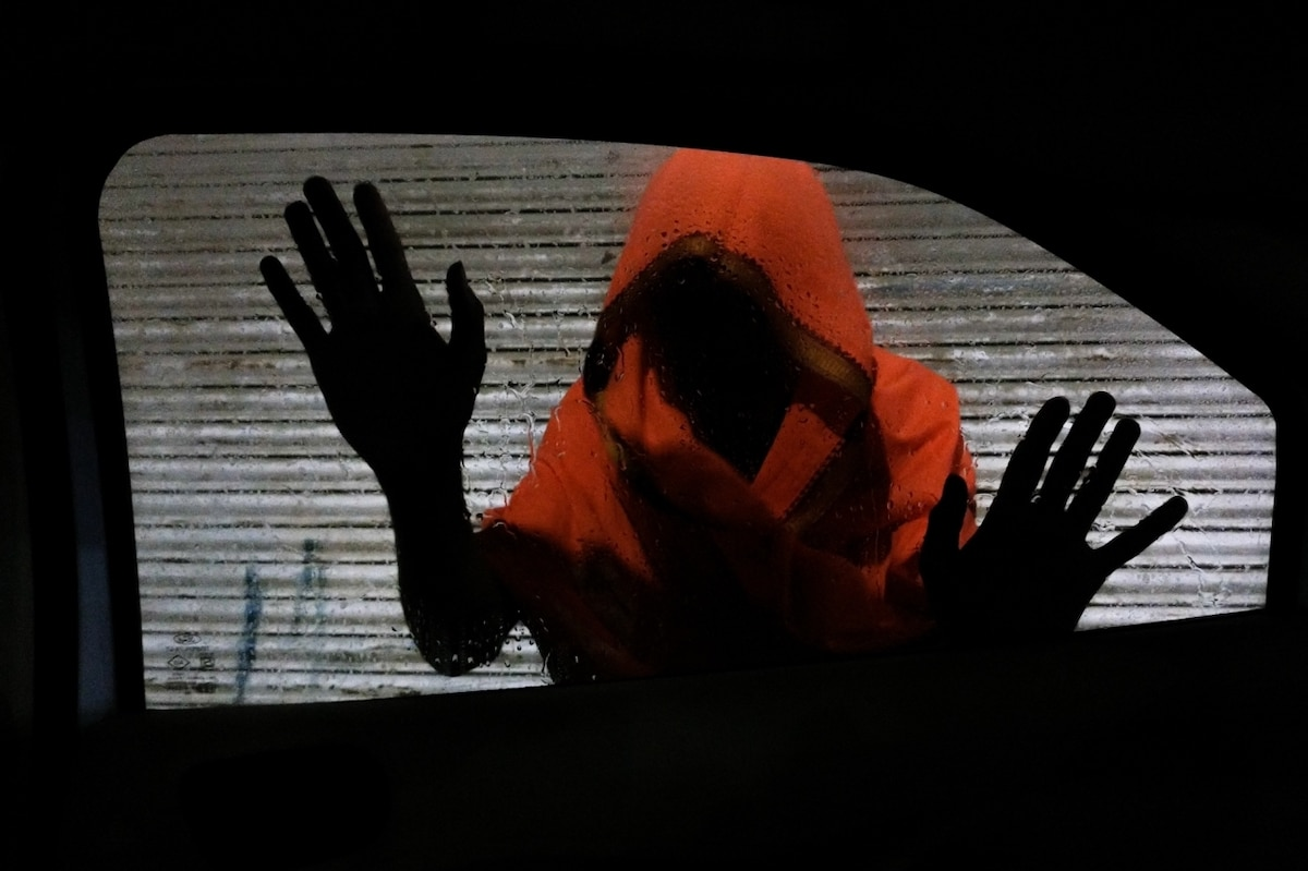 Woman With Hidden Face with Hands Placed Against Car Window