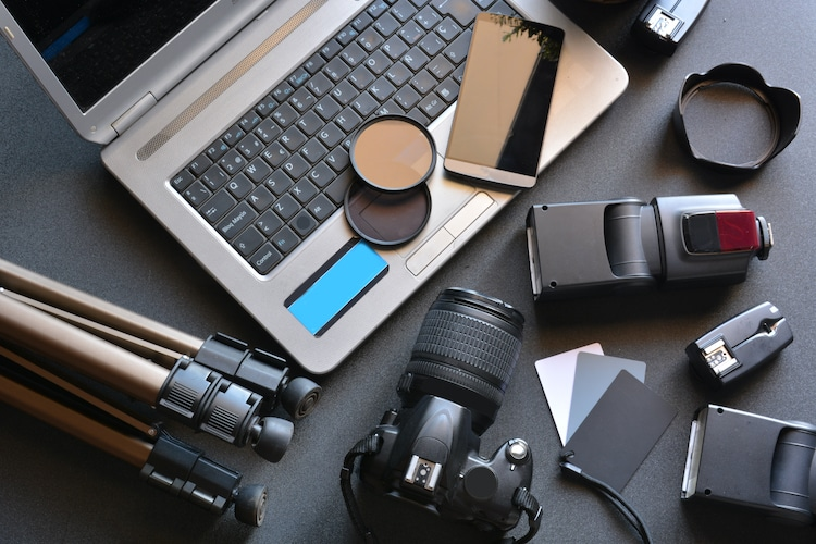 Camera, Photography Supplies, and a Computer