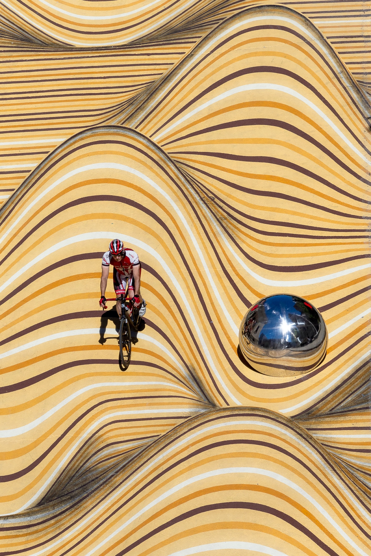 Biking Across Anamorphic Mural Moving Dunes