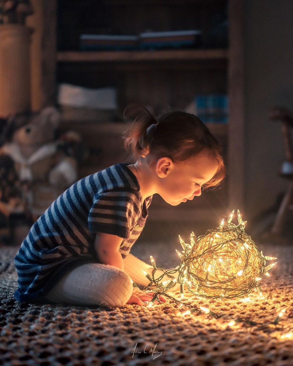 Girl Looking at Ball of Lights