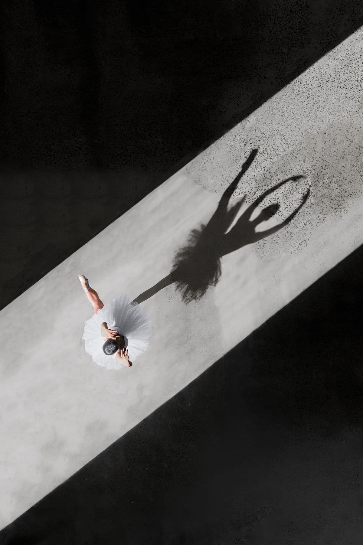 Ballerina Photographed with Shadow Cast on Pavement