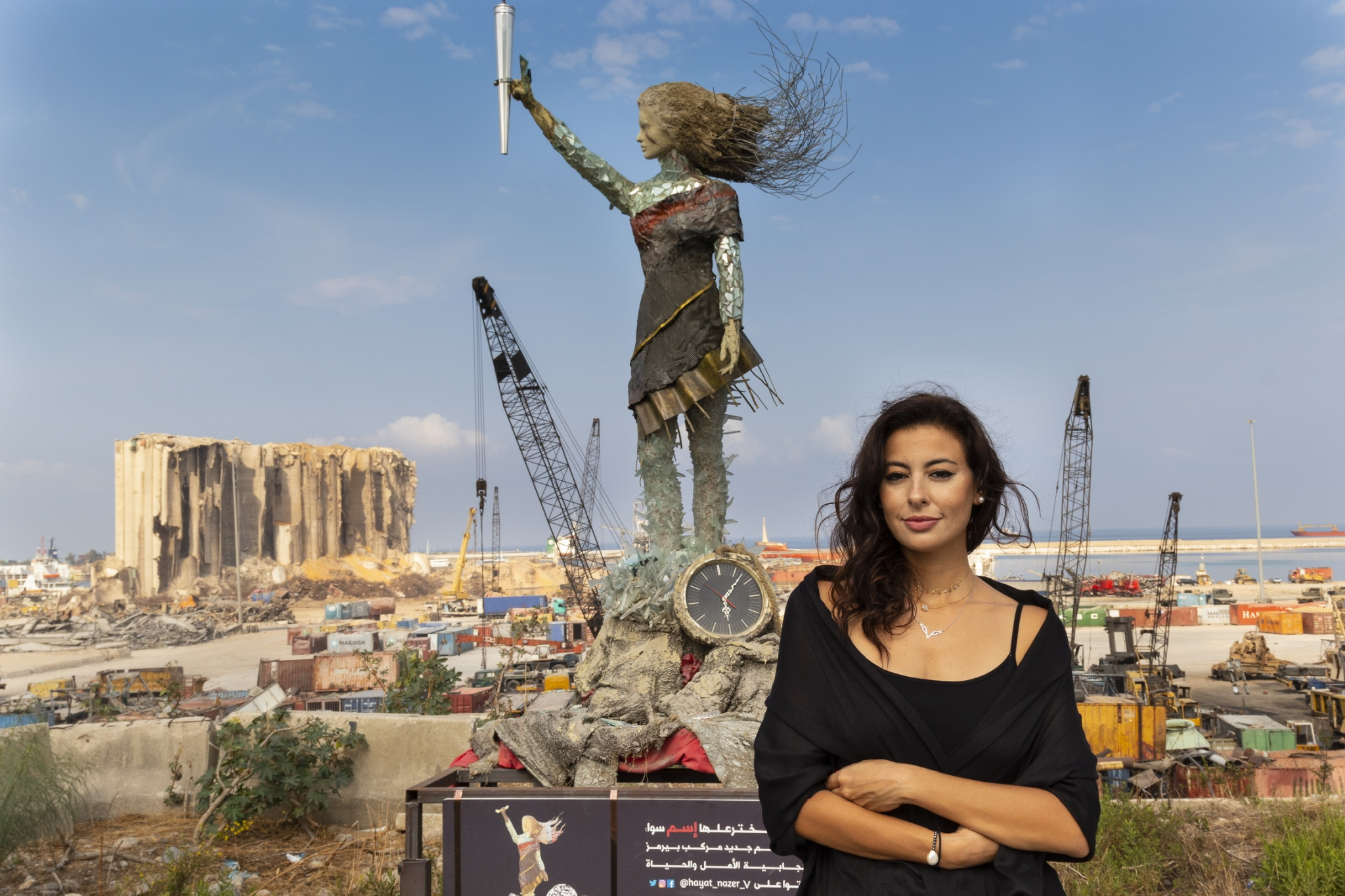 Hayat Nazer Posing In Front of Sculpture Made from Rubble of Beirut Port Explosion