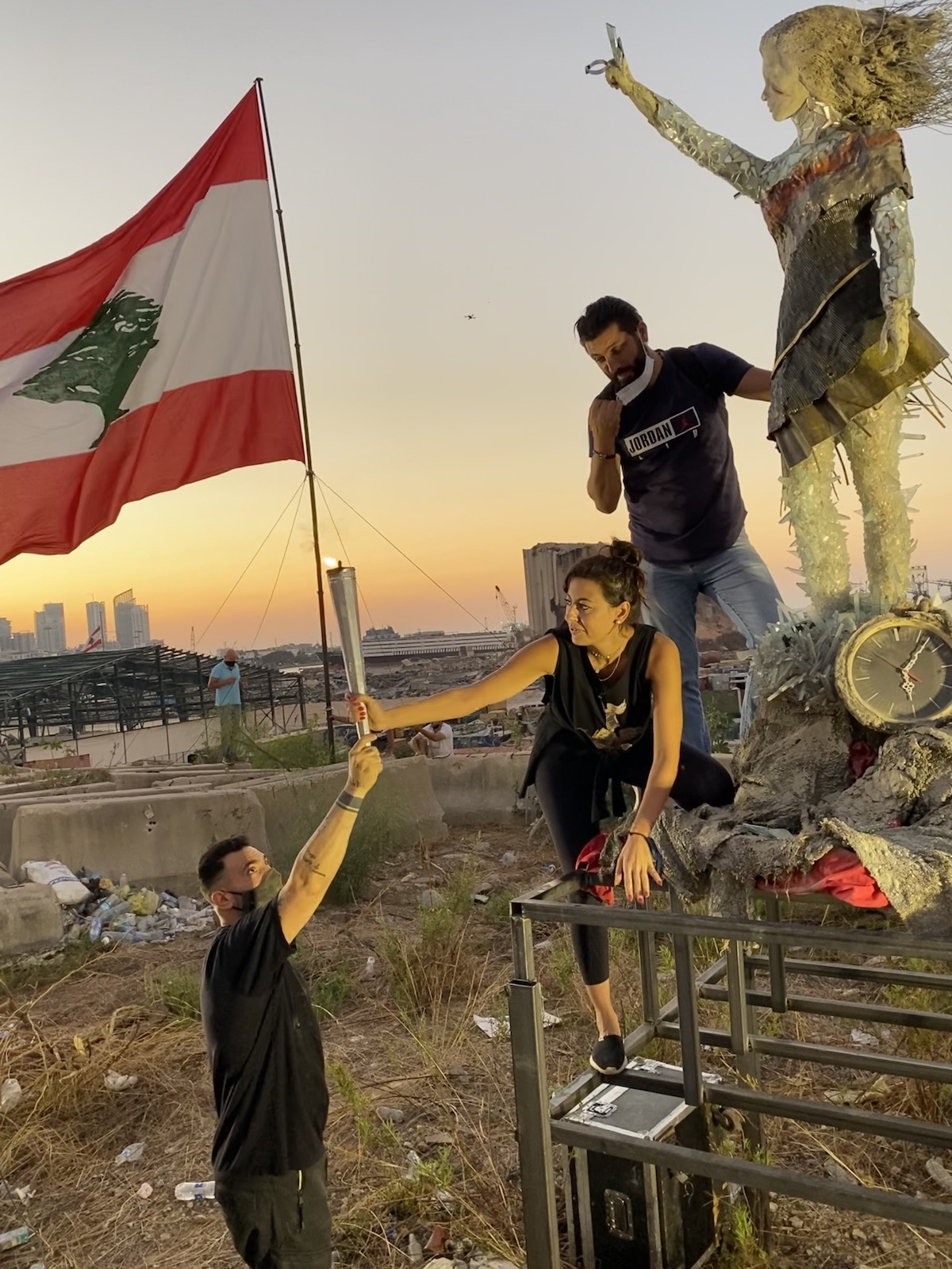 Placing Lebanese Flag in the Hands of Revolutionary Sculpture