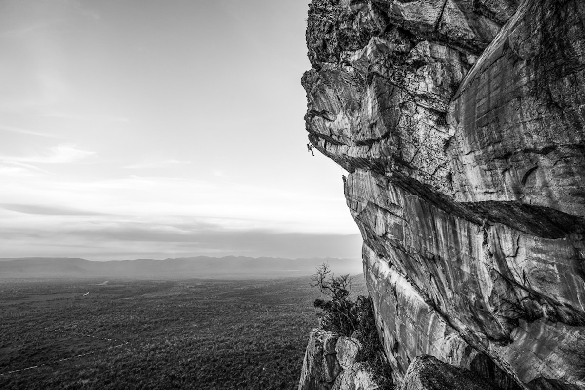 Rock Climber Dangling Off the Face of a Rock