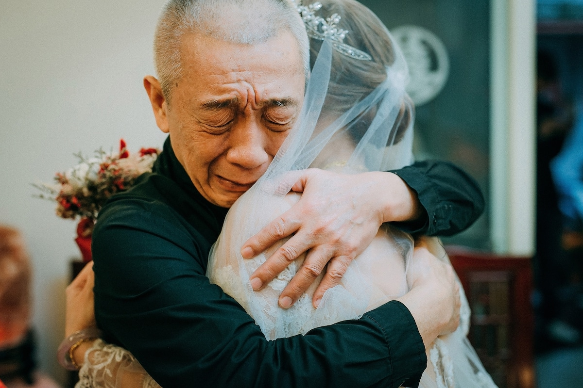 Father Hugging His Daughter at a Wedding