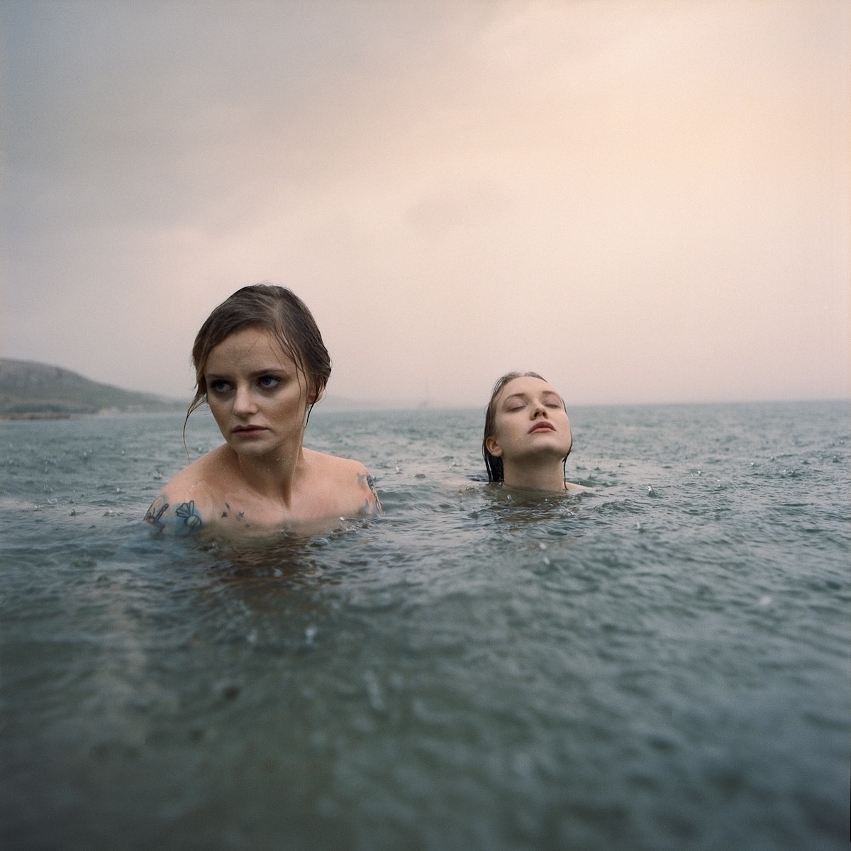 Two Women Emerging from Water
