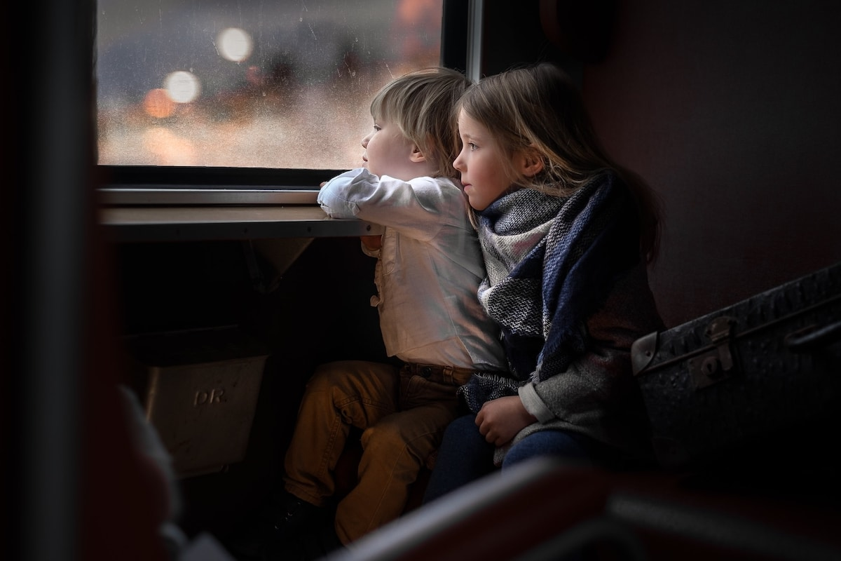 Two Children Staring out the Window