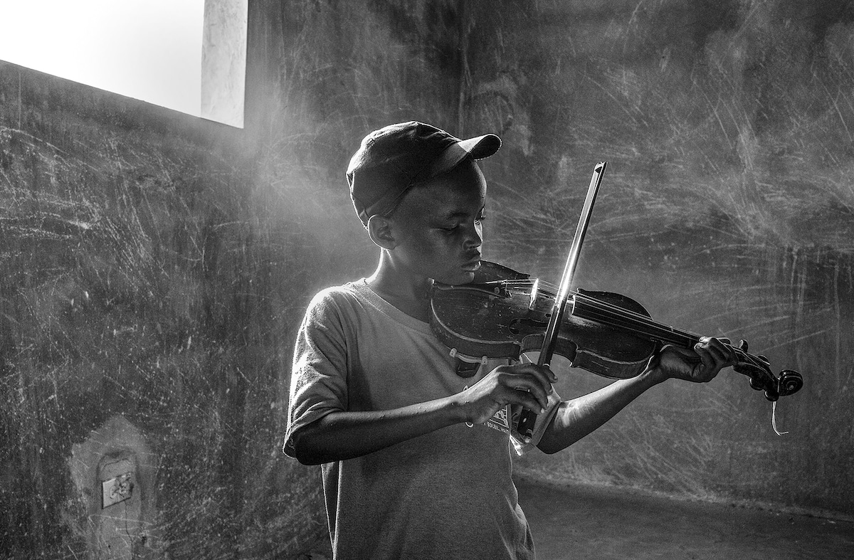 Black and White Photo of a Boy Playing the Violin