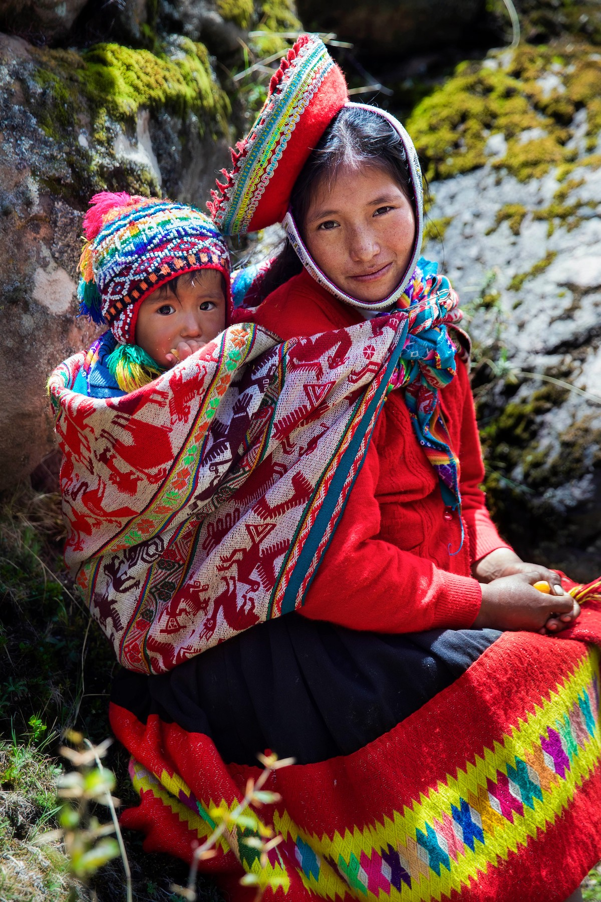 Woman and her son in the Andes Mountains