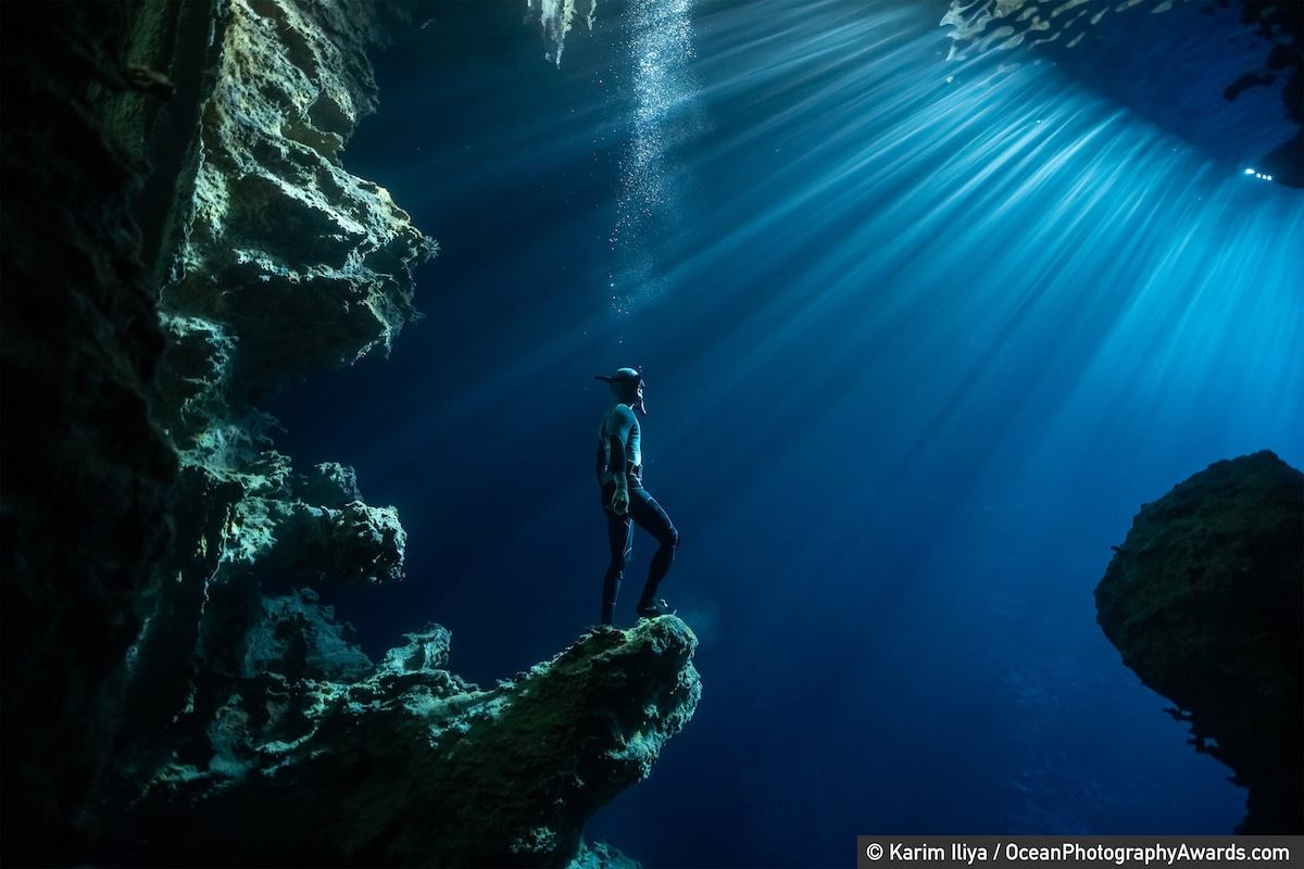 A freediver explores a cave in Tonga.