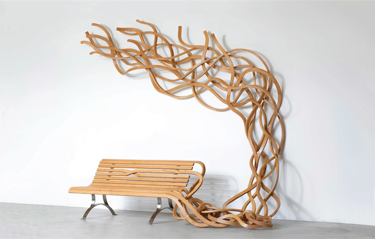 Artist Transforms Normal Wooden Benches Into Dynamic Curling Pieces of Art