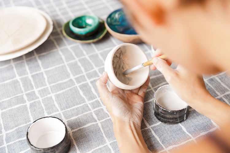 Person Painting Pottery