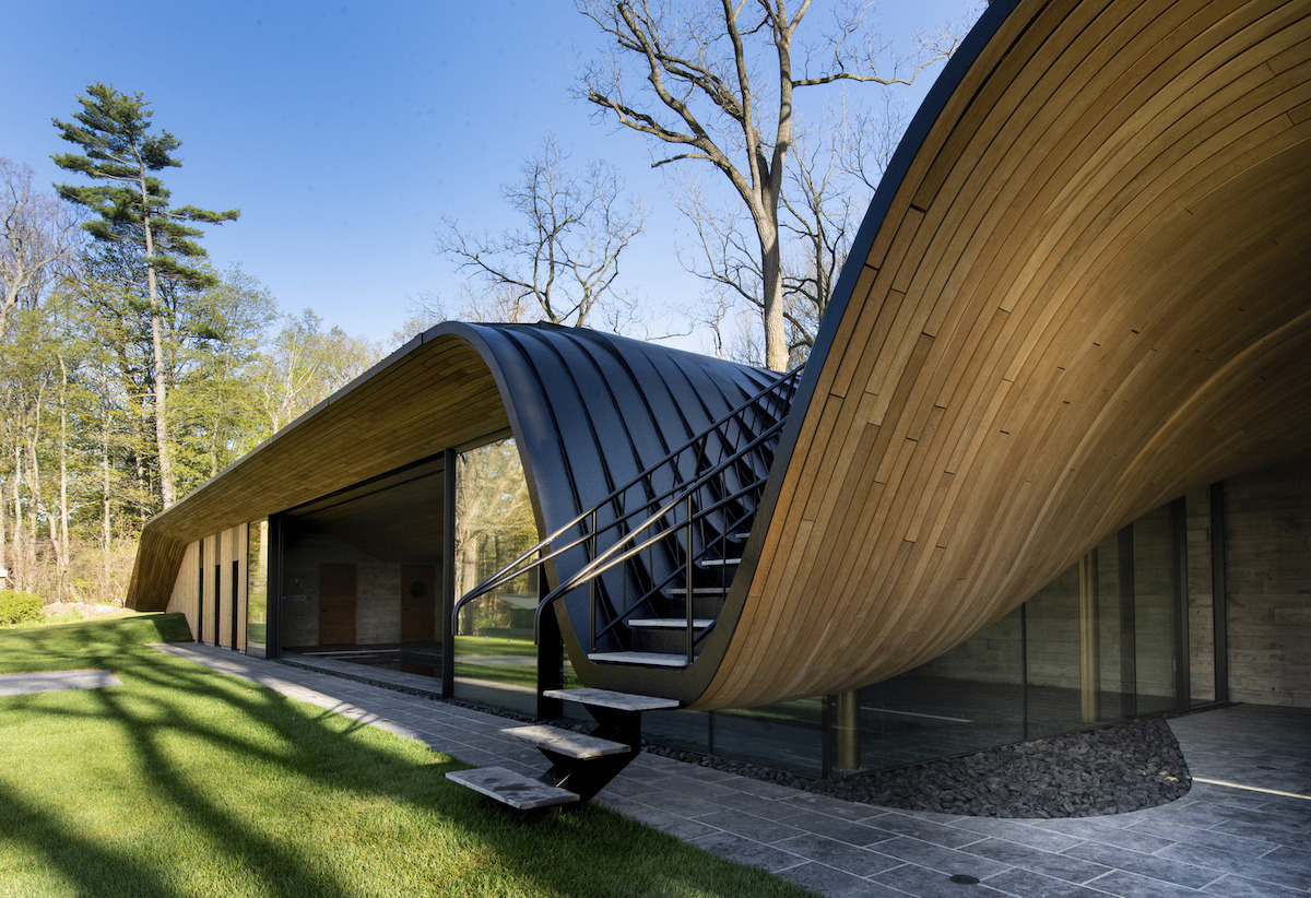 """Fold House"" Uses Compression-Bent Wood to Blend into the Hillside"