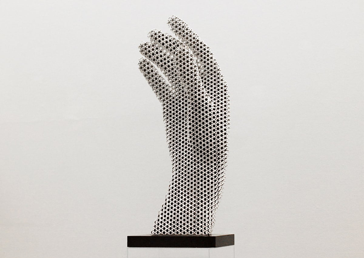 Sculptor Creates Mesmerizing Halftone Sculptures from Hundreds of Metal Pipes