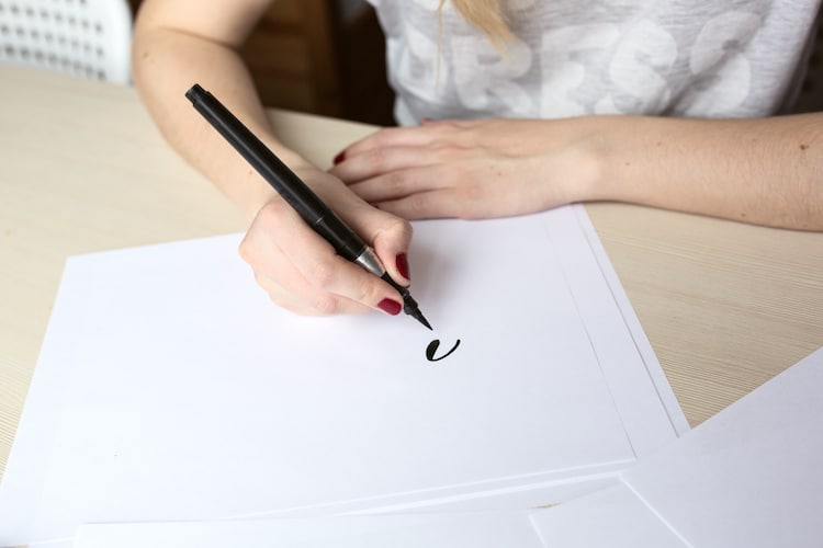 Person Drawing With a Brush Pen