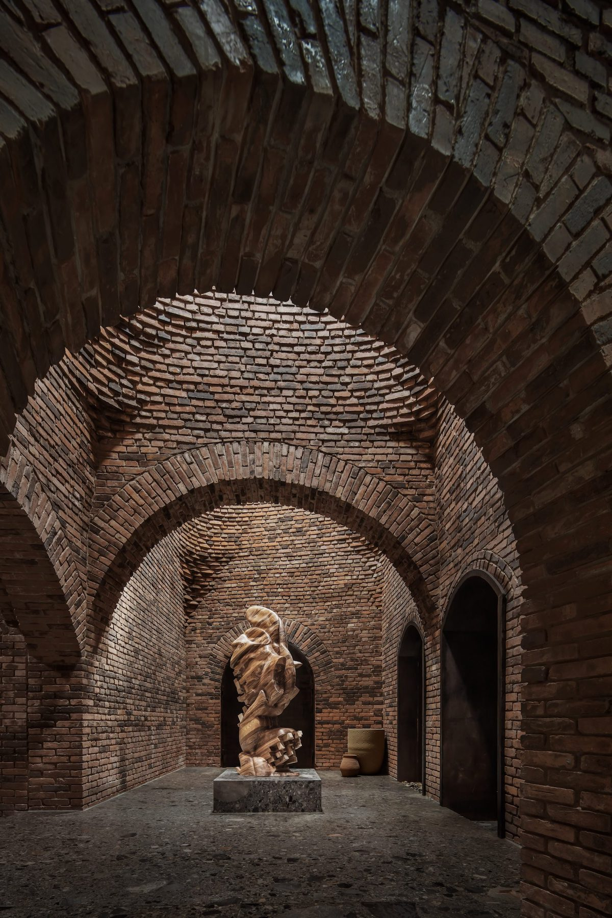 Brick Interior With Abstract Sculpture in the Middle