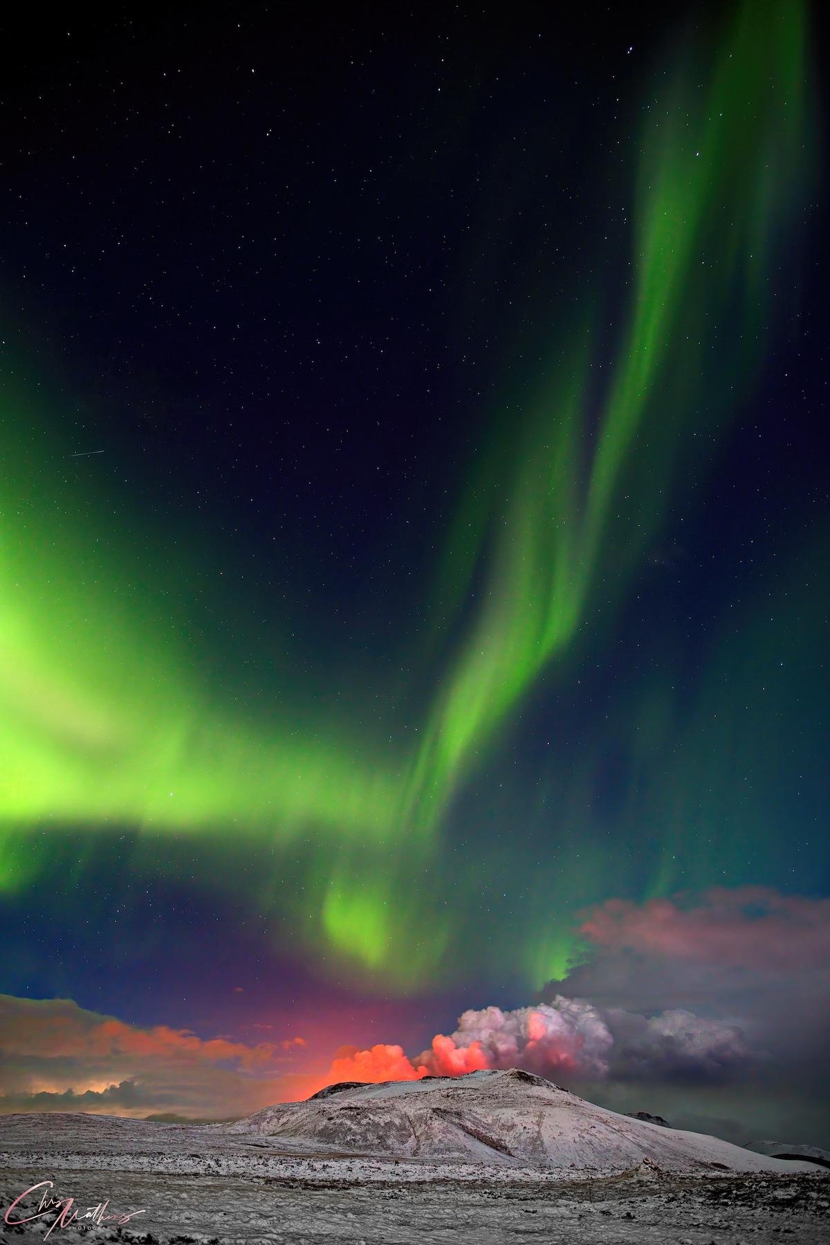 Aurora Borealis Over Erupting Geldingadalur volcano in Iceland