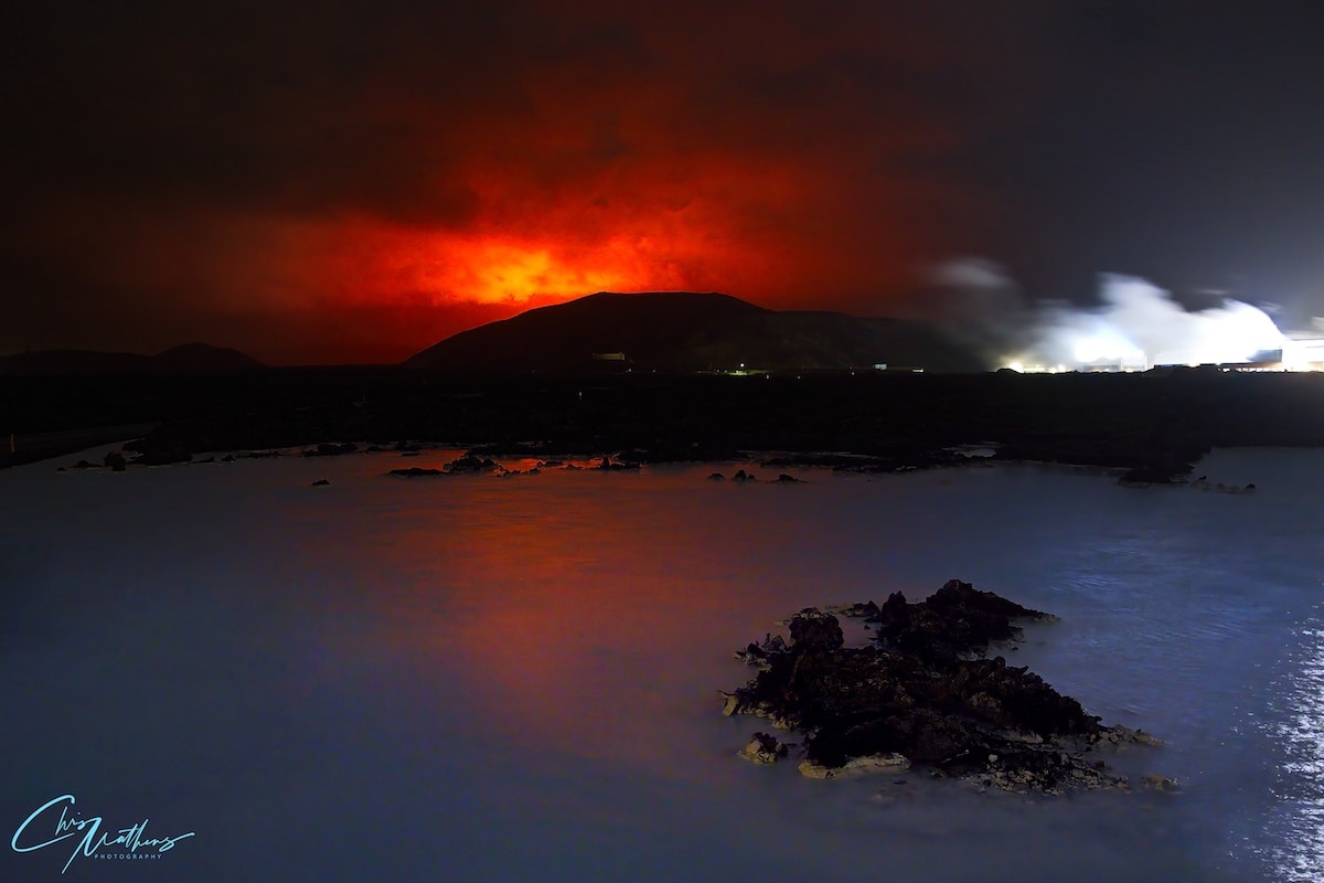 Eruption of Geldingadalur Volcano in Iceland as seen from Blue Lagoon spa and resort