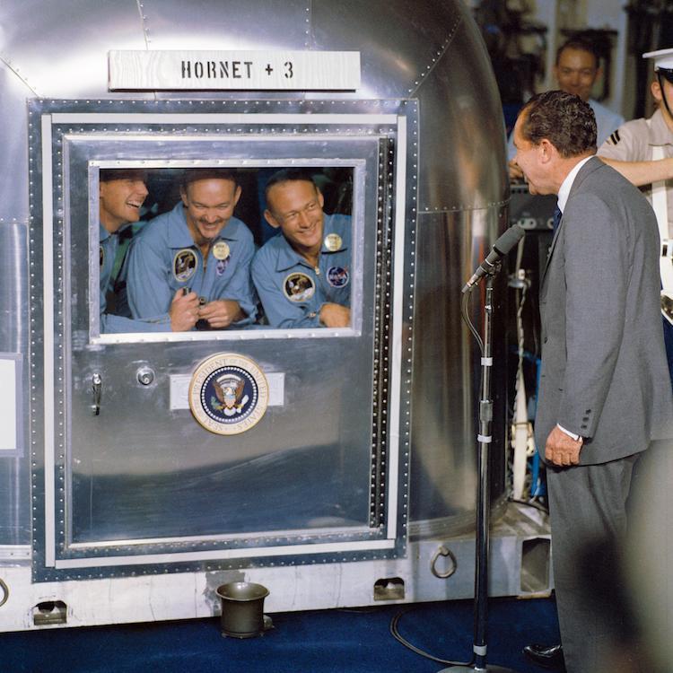 President Richard Nixon visiting the Apollo 11 crew aboard the USS Hornet.