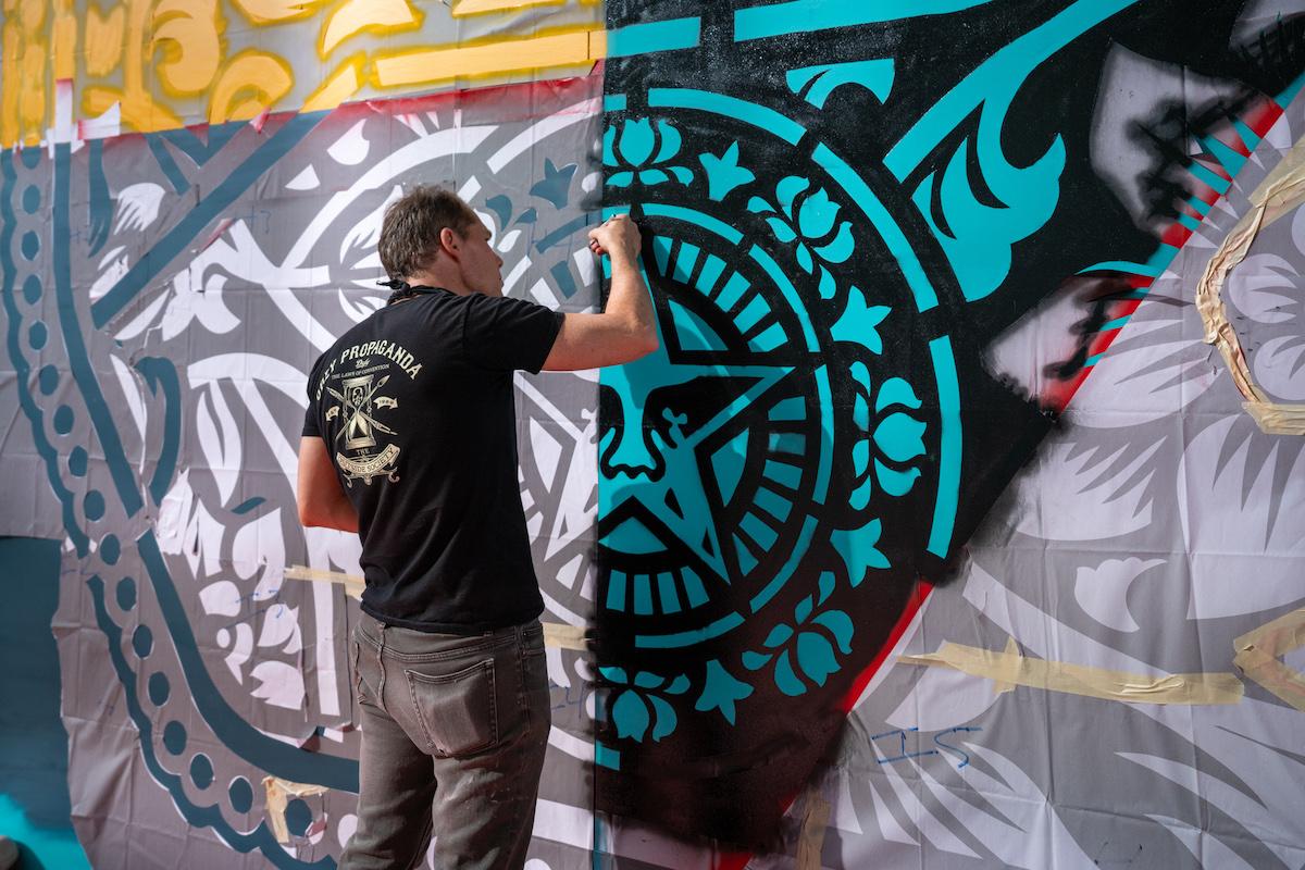 Shepard Fairey Spray Painting Mural in Dubai
