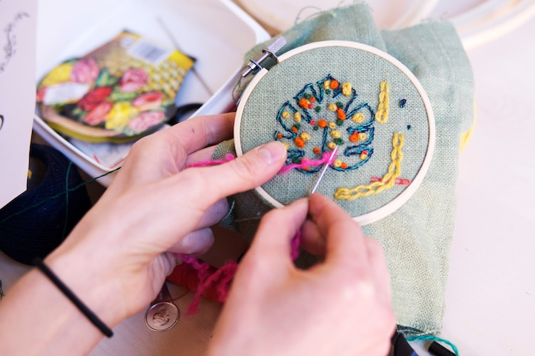 Person Stitching in an Embroidery Hoop
