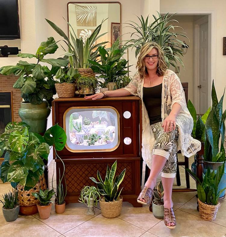 Woman Posing With Plants and Unique Terrarium in Television