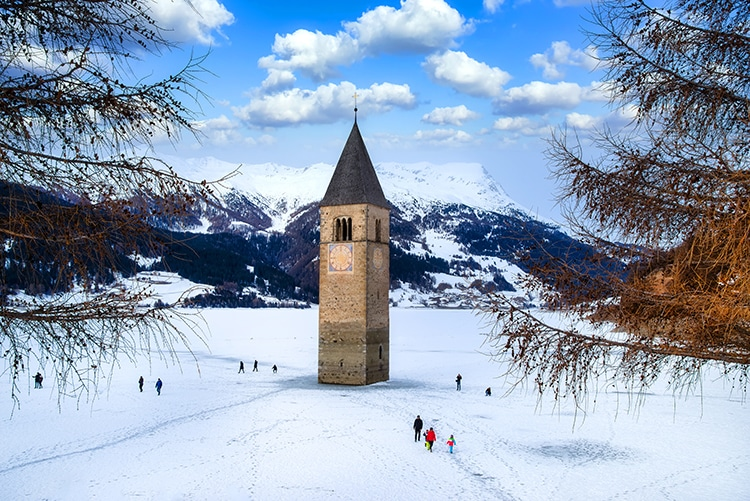 Lake Resia and Curon Tower in Winter