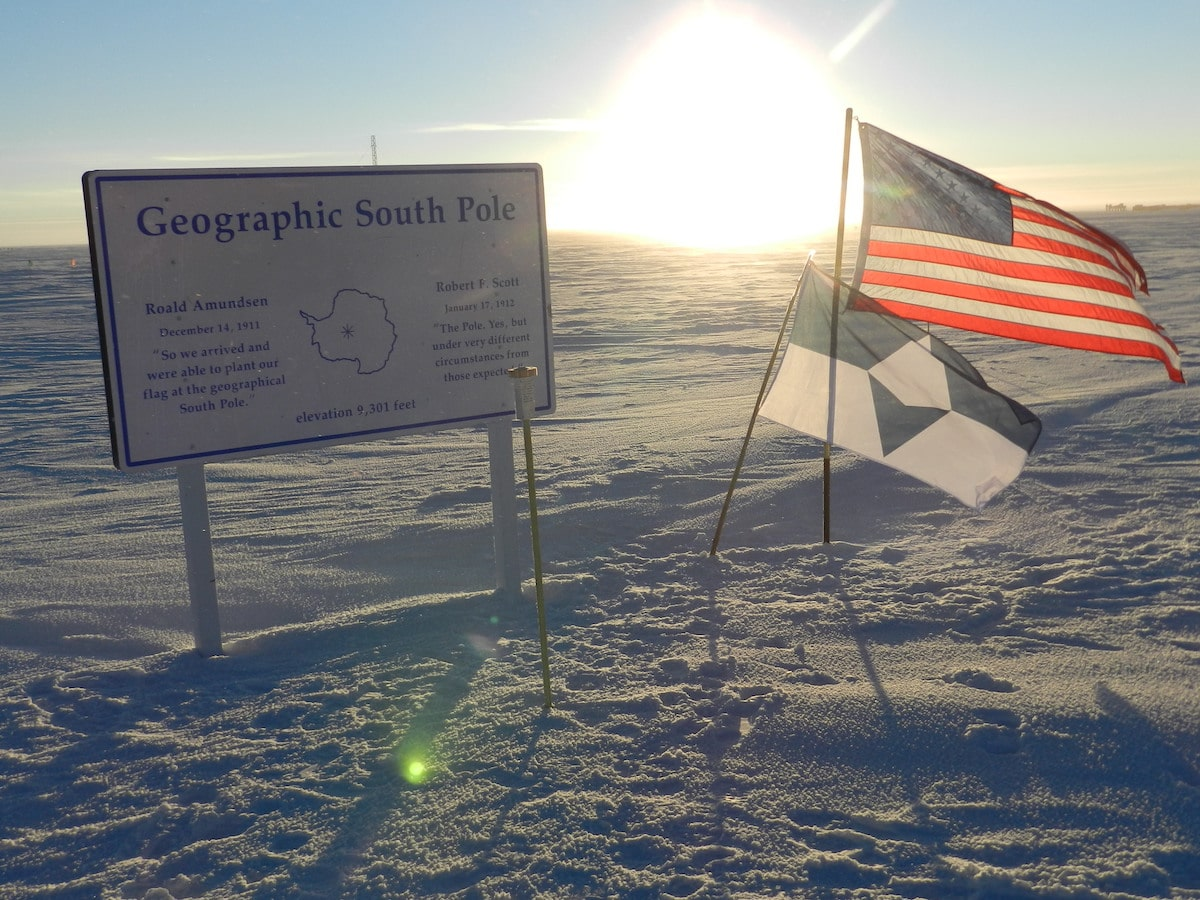 True South and the American flag at the Geographic South Pole