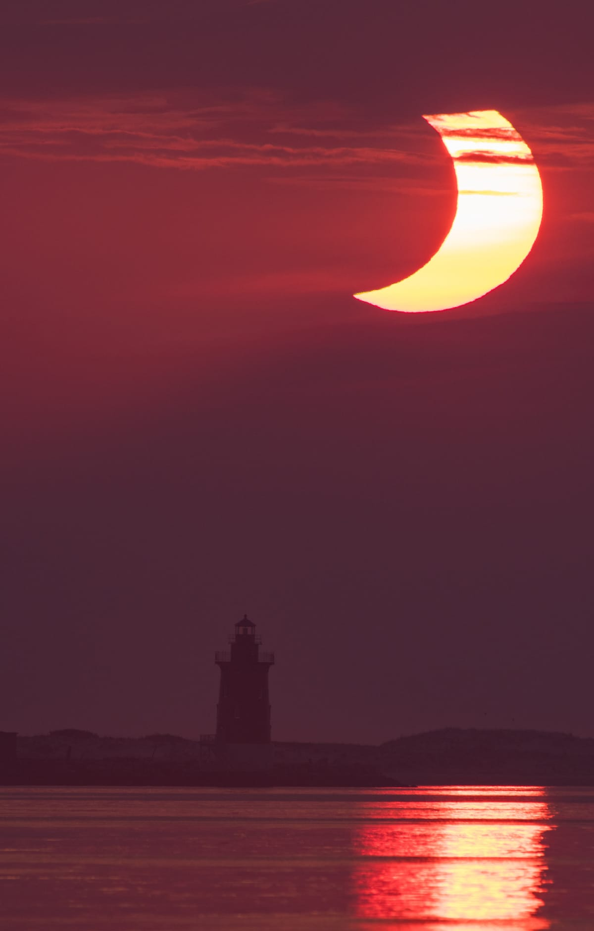 Solar Eclipse Over Lighthouse in Delaware