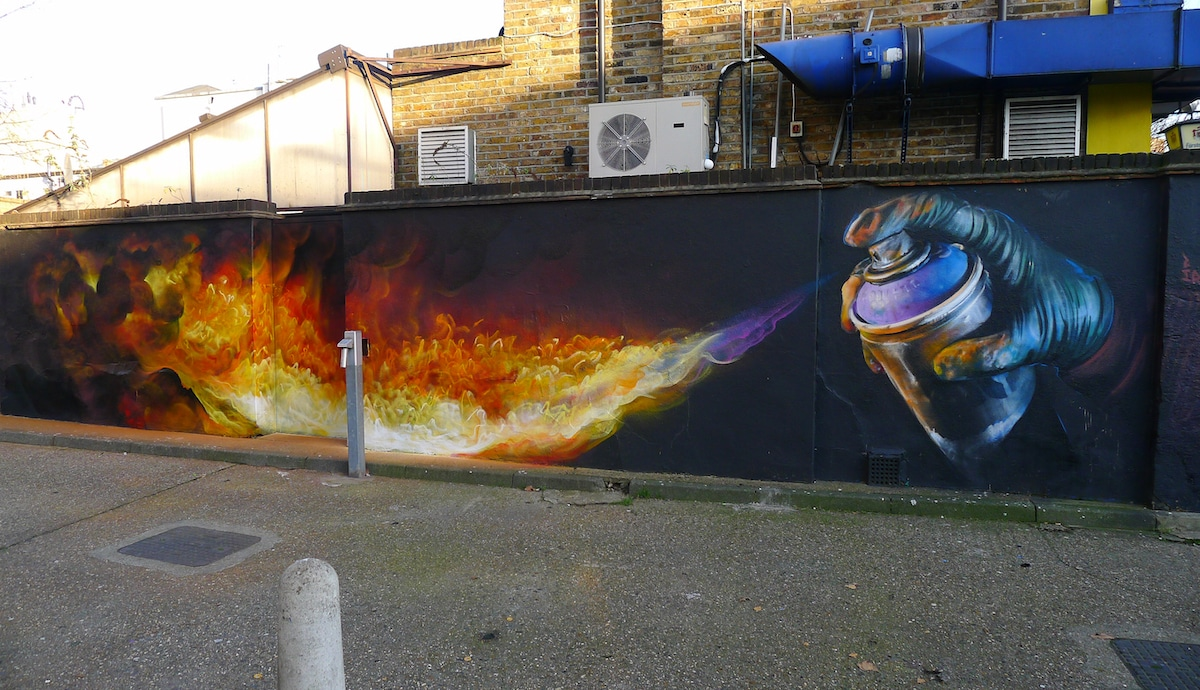 Mural of Spray Can Shooting Flames in Camden by Irony