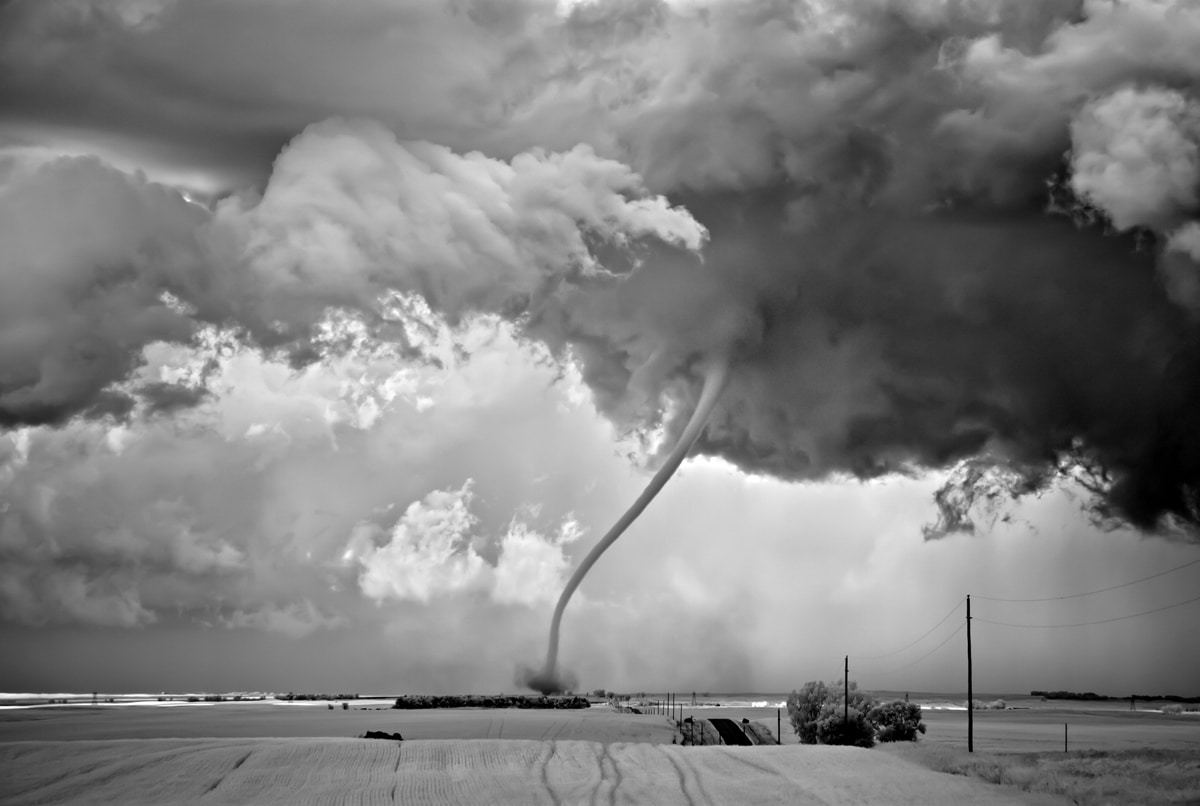 Black and White Landscape Photo of Tornado Touching Down by Mitch Dobrowner