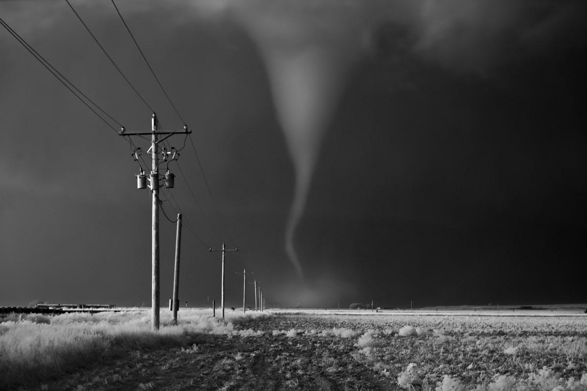 Tornado Crossing Power Poles by Mitch Dobrowner