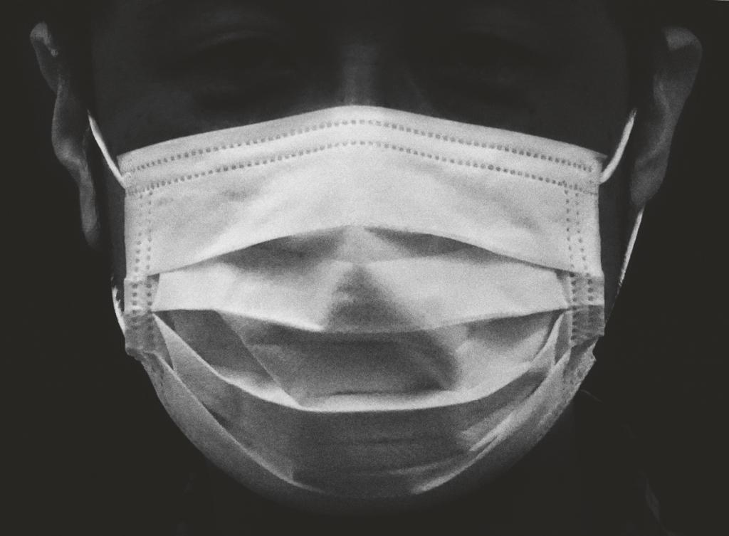 Man with a Mask by Sukita