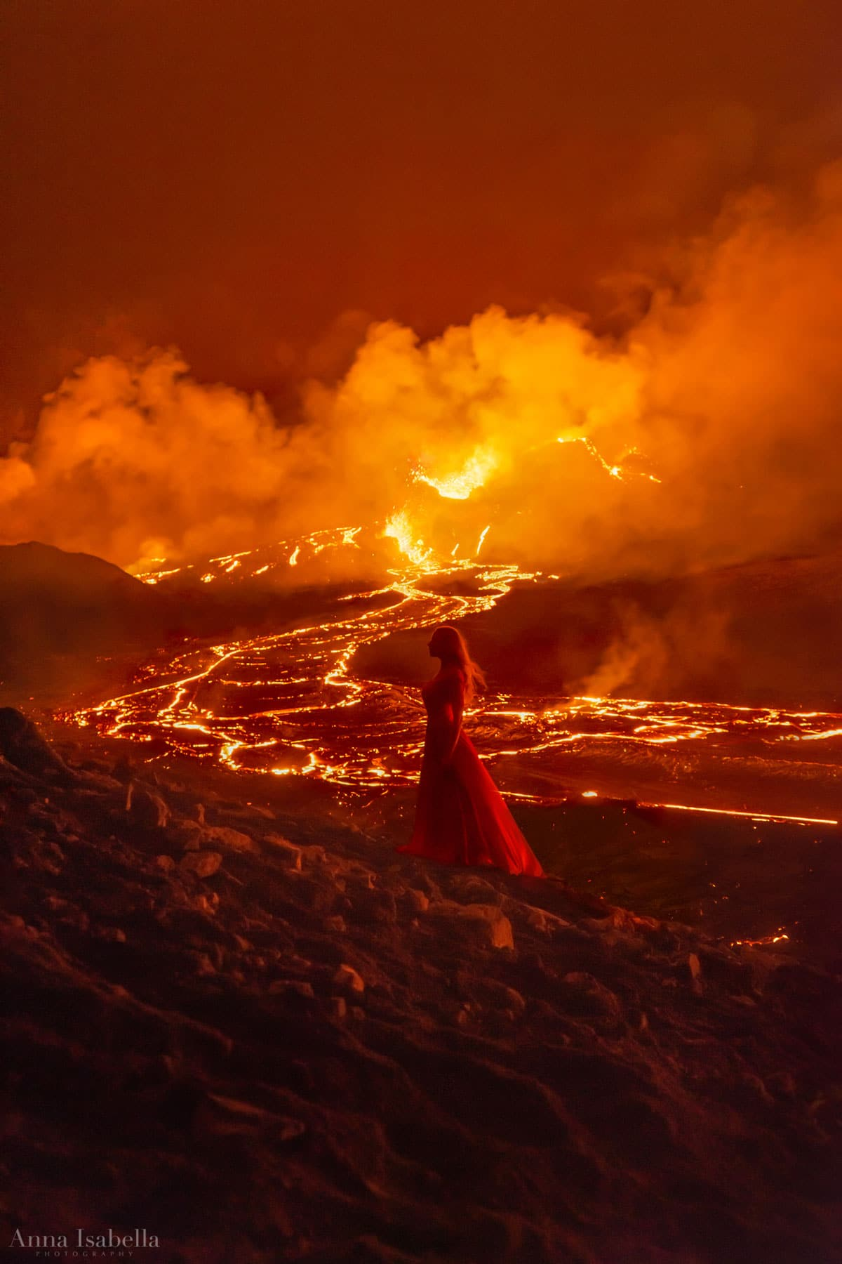 Portrait of a Woman Next to Erupting Volcano in Iceland