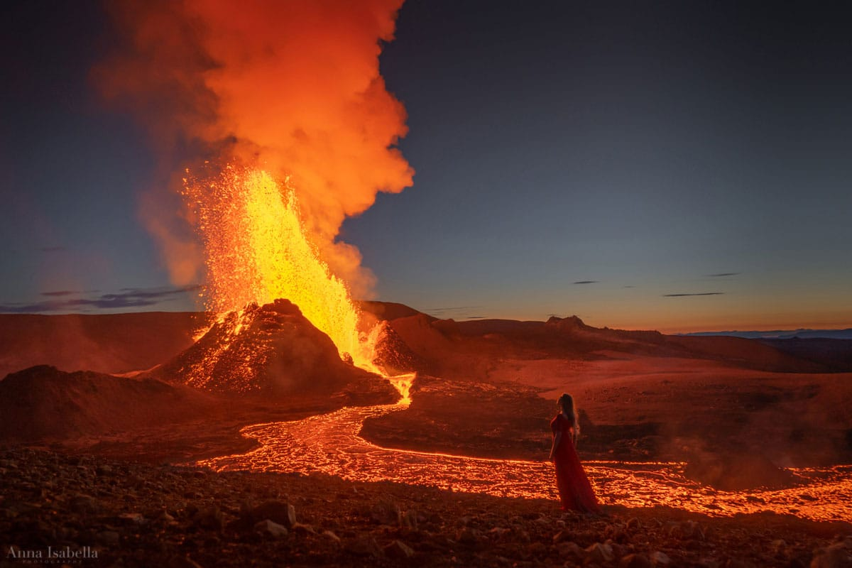 Woman Posing in Front of Lava Flow