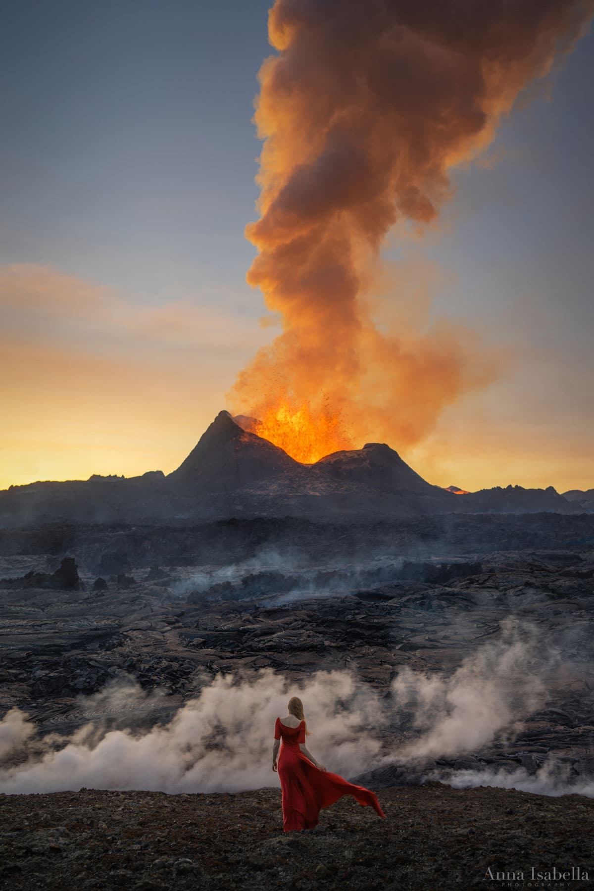 Woman in Red Dress Posing in Front of Fagradalsfjall Volcano in Iceland