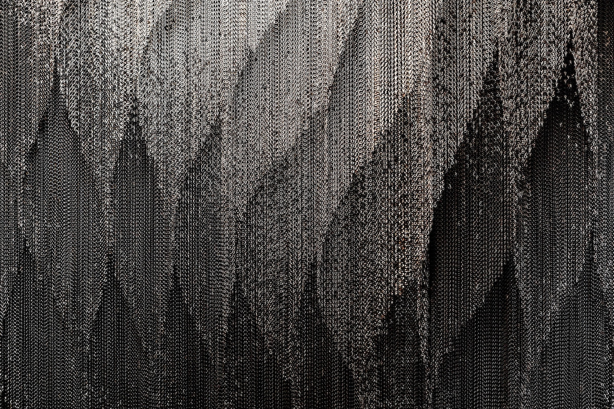 Parallel View of Curtains in Kengo Kuma Aluminum Chain Staircase in Gaudí's Casa Batlló, Captured by Jordi Anguera