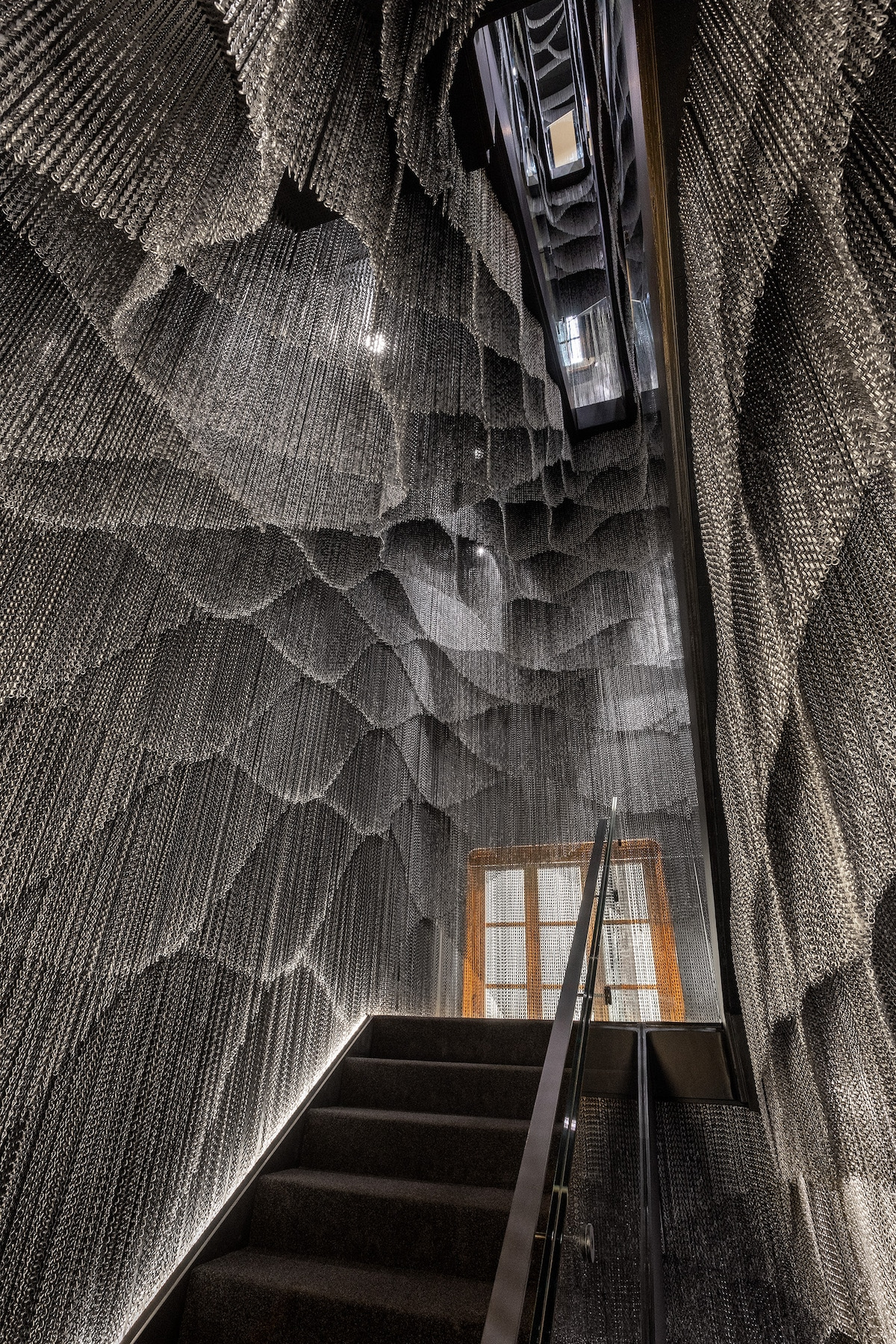 Inside Kengo Kuma Aluminum Chain Staircase in Gaudí's Casa Batlló, Captured by Jordi Anguera
