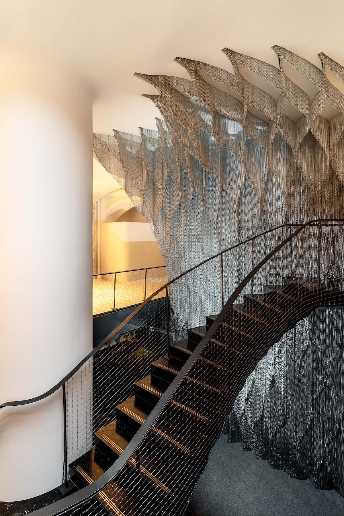 Looking Down At Kengo Kuma Aluminum Chain Staircase in Gaudí's Casa Batlló, Captured by Jordi Anguera