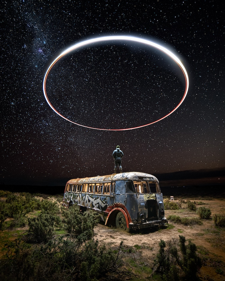 Man Standing on Abandoned Bus at Night with Circular Light Painting Above His Head