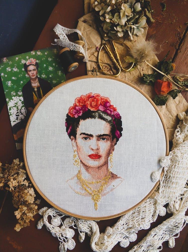 Cross-stitch portrait of Frida Kahlo