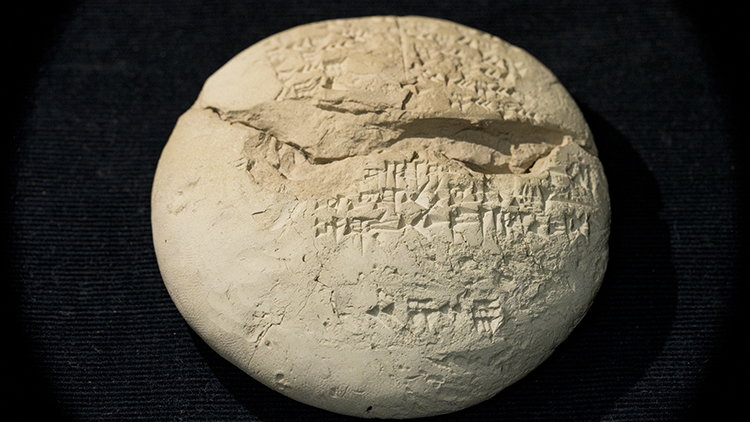 On the back of the Babylonian tablet we see text, written in cuneiform