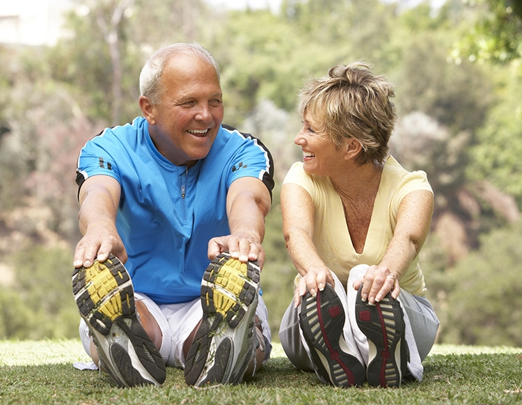 Senior Couple Exercising In Park, Metabolism Declines after 60